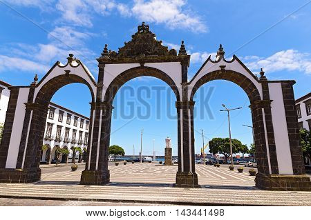 Portas da Cidade gates in Ponta Delgada the capital of Azores Portugal. Town square with the historical entrance overlooking the ocean.