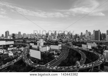 Black and White, Aerial view highway road curved with city downtown background