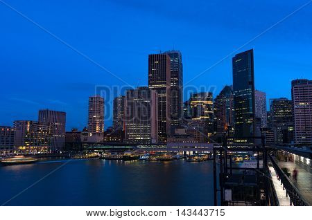 Aerial view of Sydney Central Business District skyscrapers on dusk. Urban landscape view from above. Circular Quay Australia