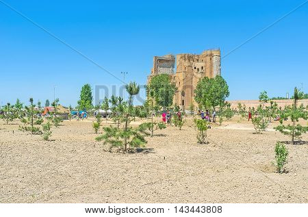 SHAKHRISABZ UZBEKISTAN - MAY 2 2015: The workers landscape a large park in the old city center around the ruins of Ak-Saray Palace on May 2 in Shakhrisabz.