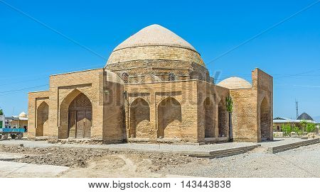 The covered market with the interesting brick dome in the old town Shakhrisabz Uzbekistan.