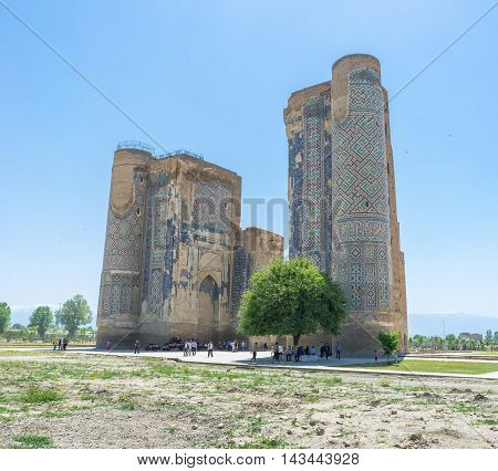 SHAKHRISABZ UZBEKISTAN - MAY 2 2015: One of the main landmarks of old Shakhrisabz is the ruins of Ak-Saray Palace on May 2 in Shakhrisabz.
