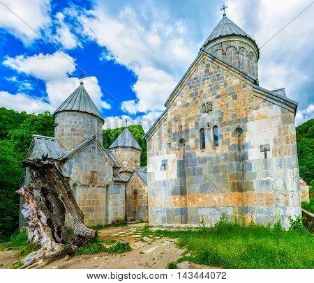 The grey stone domes of St Astvatsatsin St Stepanos and St Gregory Churches of Haghartsin Monastery Armenia.