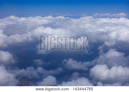 Aerial view of white fluffy clouds floating above land