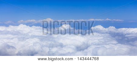 endless white clouds under bright blue sky