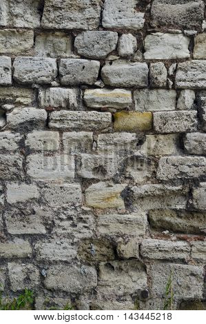 Historical Buildings Stone Wall Background, Natural worn rock stone