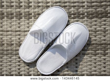Disposable soft white slippers for HOTEL`S closeup