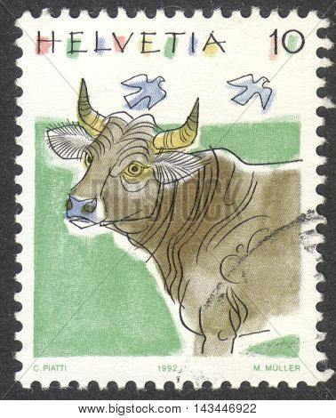 MOSCOW RUSSIA - CIRCA JULY 2016: a post stamp printed in SWITZERLAND shows a cattle (Bos primigenius taurus) the series