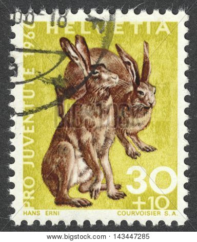 MOSCOW RUSSIA - CIRCA JULY 2016: a post stamp printed in SWITZERLAND shows rabbits (Lepus europaeus) the series