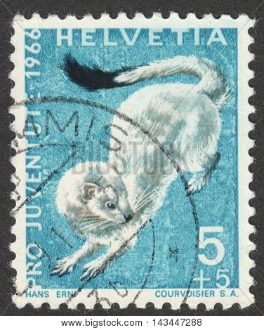 MOSCOW RUSSIA - CIRCA JULY 2016: a post stamp printed in SWITZERLAND shows an erminel (Mustela erminea) the series
