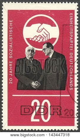 MOSCOW RUSSIA - CIRCA JULY 2016: a stamp printed in DDR shows W. Pieck and O. Grotewohl the series