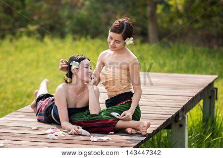 Beautiful woman wearing in Thai traditional costume.