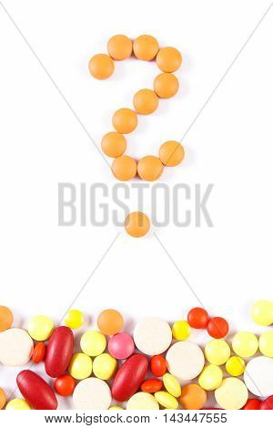 Question Mark Made Of Medical Pills And Tablets On White Background, Health Care Concept