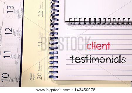 Client testimonials news text concept write on notebook