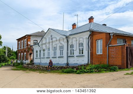 KALYAZIN RUSSIA - JULY 22 2016: Unidentified tourists are near house of Princes Shehonskih (one of landmarks of city monument of architecture of XVIII century) in Zarechenskaya part of Kalyazin