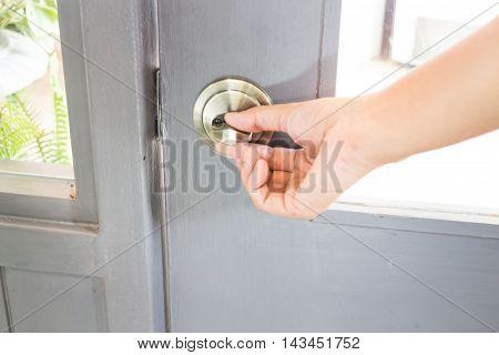 Hand holding the door locker stock photo
