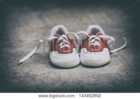 a pair of small shoes. with a classic feel retouch