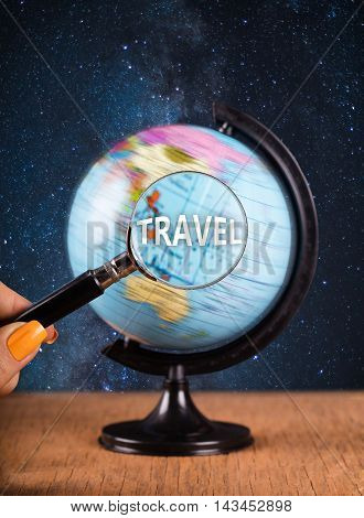 globe and magnifying glass standing on the table