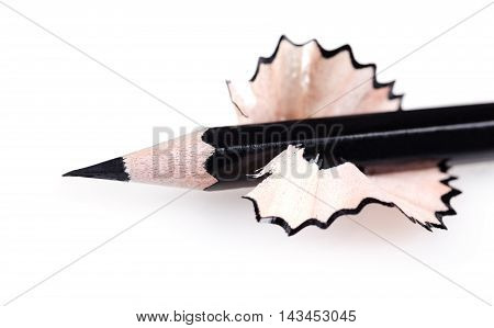 black sharpened pencil close-up on a white background