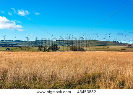 Windmill electricity turbine with rural outback background. Farmland and wind turbines. Myrtleville NSW Australia