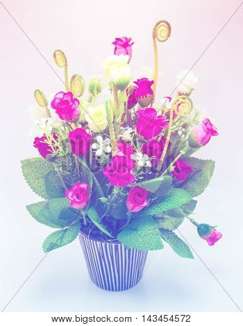 Artificial flowers in ceramic vase with color filter
