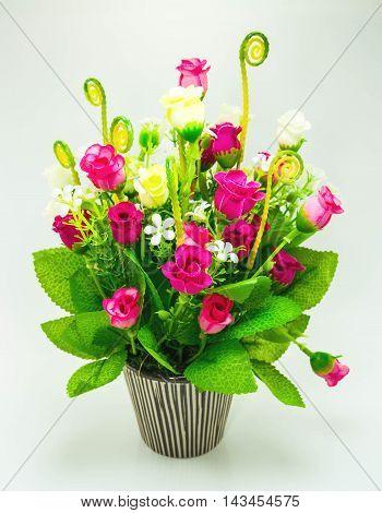 beautiful artificial flowers in ceramic vase .