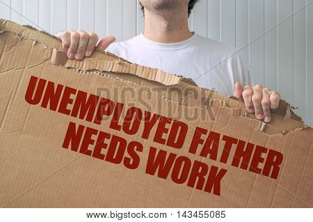 Unemployed father needs work man holding banner with job seeking title
