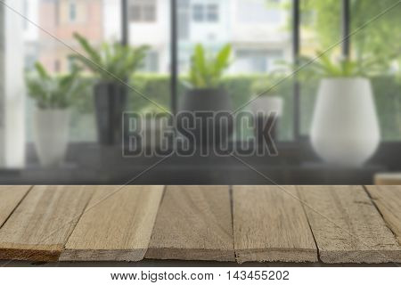 wood table top on blur background of lobby view - can use to display or montage product