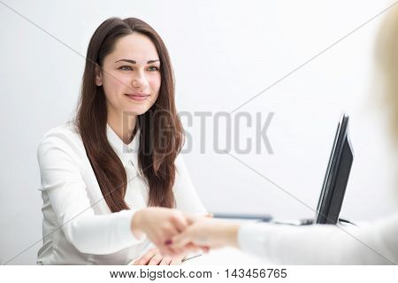 Young Business Woman In The Office Concludes Contract