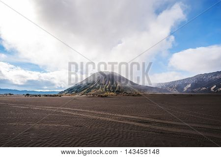 Landscape, Mount Bromo with tyre tracks, adventure concept