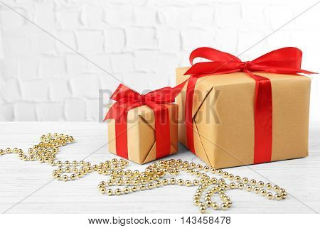 Gift boxes and Christmas decor on brick wall background