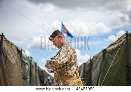 Mykolaiv, Ukraine - July 18: Ukrainian soldier stands at Ukrainian-US military camp in Shyrokiy Lan army training range.