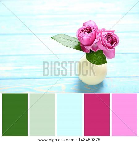 Beautiful Pink Roses On A Blue Wooden Table With Color Palette