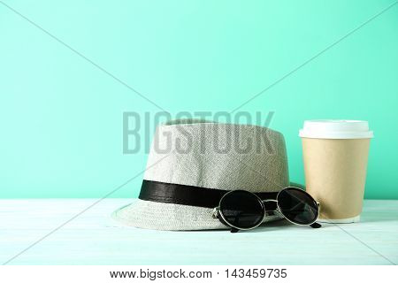 Pretty Hat With Sunglasses On Wooden Table
