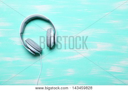 Headphones On A Mint Wooden Table, Close Up
