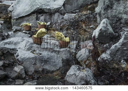 Basket of sulfur nuggets at Kawah Ijen volcano in Indonesia