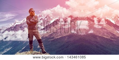 hiker at the top of a pass enjoy sunny day in Alps. Switzerland, Trek near Matterhorn mount.