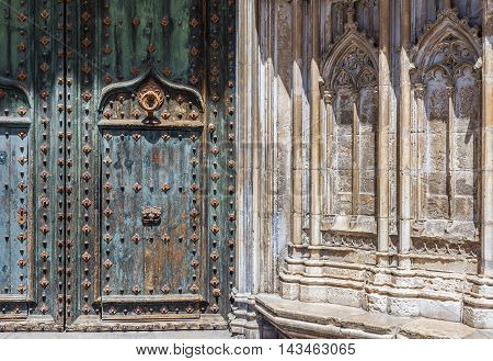 Gothic portico in south facade of Santa Maria cathedral. Gerona Costa Brava Catalonia Spain.