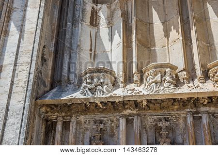 Detail of gothic portico in south facade of Santa Maria cathedral. Gerona Costa Brava Catalonia Spain.