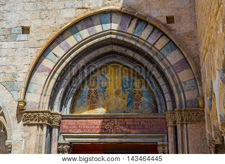 Mural in the tympanum of portico in the south facade of Basilica of Sant Feliu in Gerona. Costa Brava Catalonia Spain.