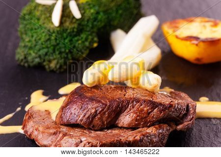 closeup of a grilled steak with asparagus