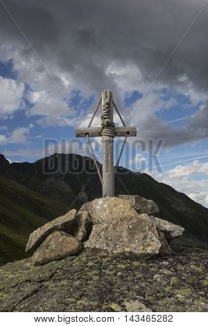 mountain cross in the austrian alps at dusk
