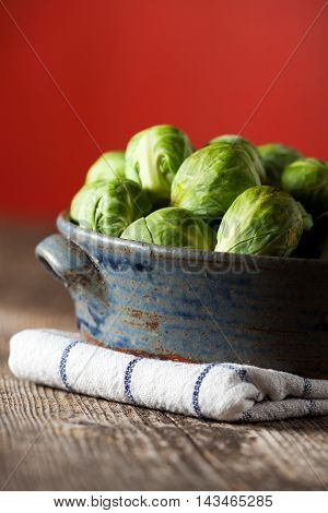 brussels sprouts in a bowl on wood