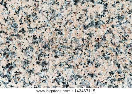 Multicolored marble texture image in high resolution. Real marble background. Marble texture background in bright colors with black dots. Abstract marble background close-up