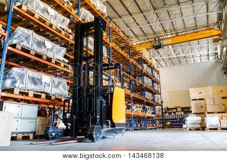 Modern warehouse with forklifts in factory, Thailand