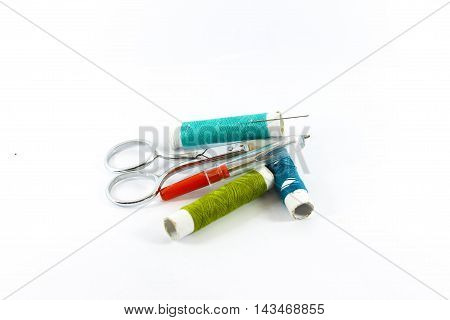 many different knitting items on White background