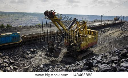 Large backhoe loader in the iron quarry in Ukraine