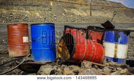 Empty metal barrels in the iron quarry in Ukraine