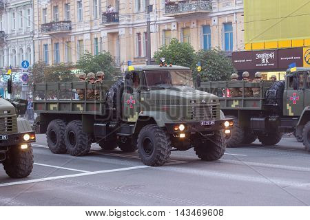 Kiev Ukraine - 19 August 2016: Driverss of KRAZ trucks preparing for parade at Kreschatyk street which will take place on the 24-rd of August dedicated to the 25-th anniversary of Independence of Ukraine.