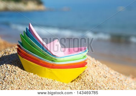 Stacked paper boats at the beach to play with